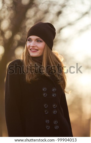 Portrait of a beautiful female model in autmn clothes outdoor.sensetive look - stock photo