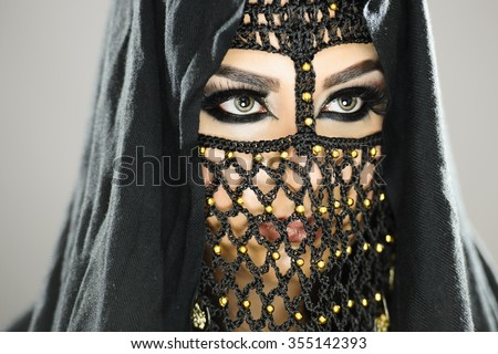 Portrait of a beautiful female model in jewellery and makeup - stock photo