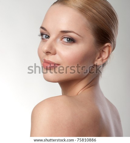 Portrait of a beautiful female model on blue background - stock photo