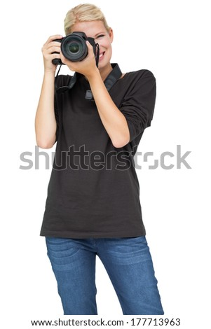 Portrait of a beautiful female photographer over white background - stock photo