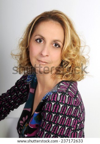portrait of a beautiful fifty years old blond woman wearing a perfect make up  - stock photo
