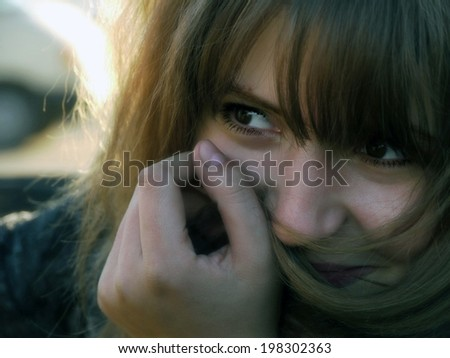 Portrait of a beautiful, frightened girl, close-up. - stock photo