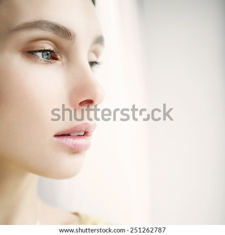 Portrait of a beautiful girl face close-up, concept of health and beauty - stock photo