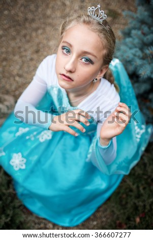 Portrait of a beautiful girl in a dress - stock photo