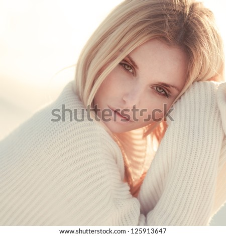 portrait of a beautiful girl in a golden tone - stock photo