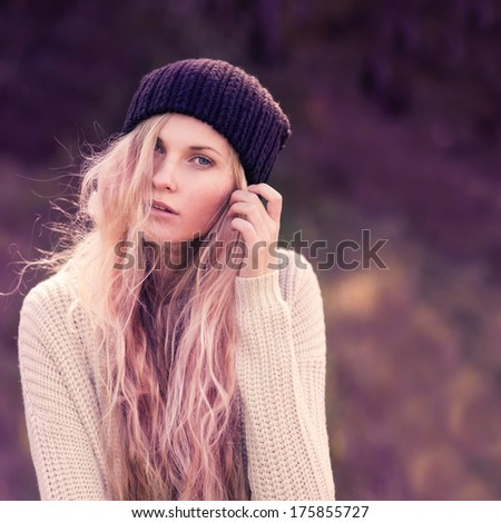 portrait of a beautiful girl in a hat hipster. photos in violet tones - stock photo