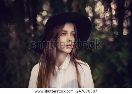 portrait of a beautiful girl in a hat in the spring - stock photo