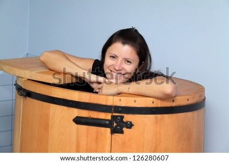 portrait of a beautiful girl in a phyto barrel - stock photo