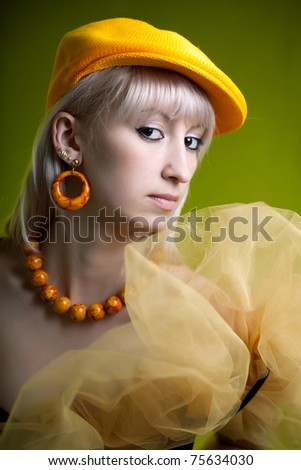 portrait of a beautiful girl in a yellow beret - stock photo