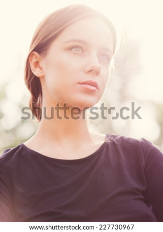 portrait of a beautiful girl in spring in a sunny day - stock photo
