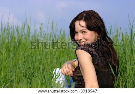Portrait of a beautiful girl in the meadow - stock photo