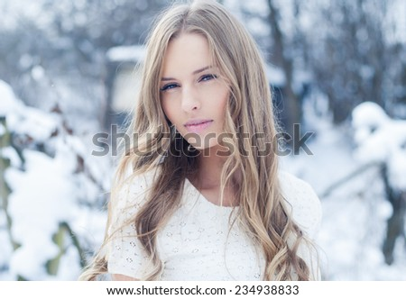 portrait of a beautiful girl in winter - stock photo