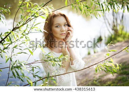 Portrait of a beautiful girl on the nature - stock photo