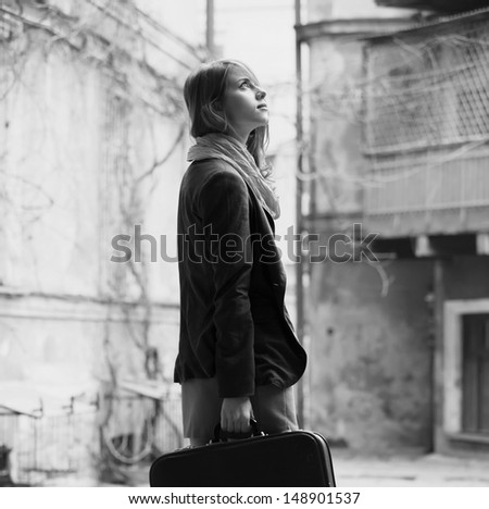 portrait of a beautiful girl on the street. Photo in vintage style - stock photo