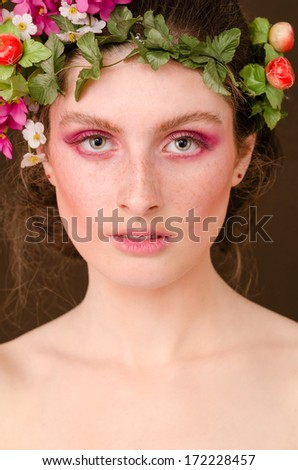 portrait of a beautiful girl symbol of grace and spring time - stock photo