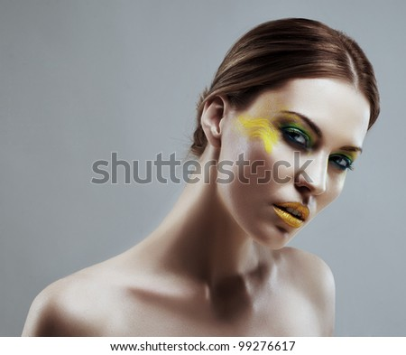 Portrait of a beautiful girl with a color make-up - stock photo