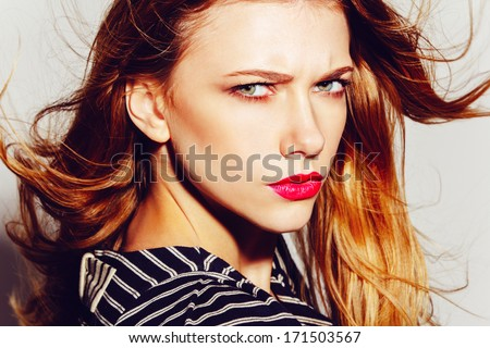 Portrait of a beautiful girl with a frown - stock photo