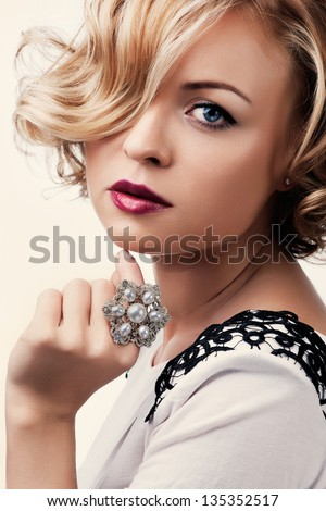 portrait of a beautiful girl with a pearl ring - stock photo