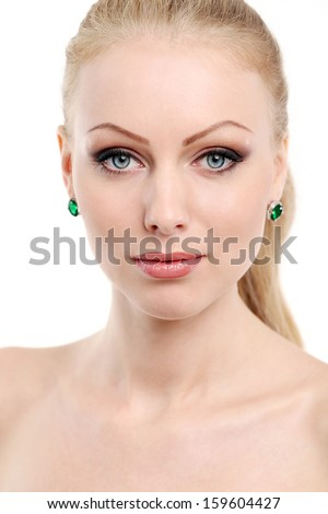 Portrait of a beautiful girl with blonde hair and naked shoulders who is posing over a white background - stock photo