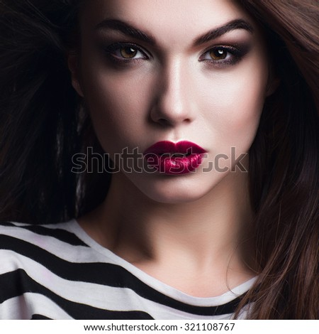 Portrait of a beautiful girl with bright makeup and red lipstick - stock photo