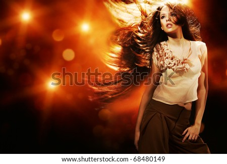 Portrait of a beautiful girl with flying long hair - stock photo