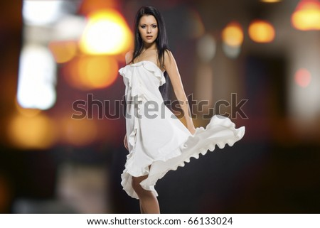 Portrait of a beautiful girl with flying white dress - stock photo