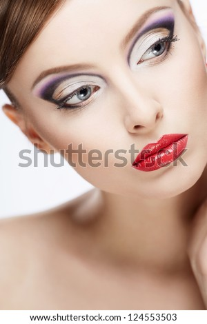 Portrait of a beautiful girl with make-up - stock photo