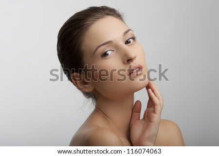 portrait of a beautiful girl with perfect skin - stock photo