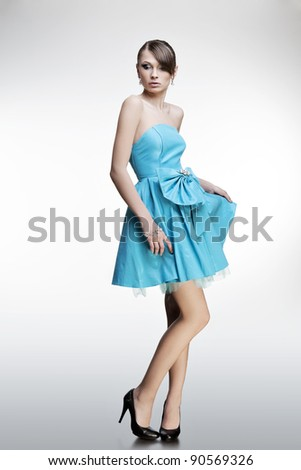 portrait of a beautiful girl with perfect skin in a dress - stock photo