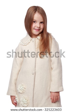Portrait of a beautiful happy little girl with long healthy hair coat in spring isolated on white/Caucasian young girl with healthy skin and well-groomed hair in a white coat - stock photo