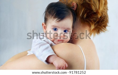 Portrait of a beautiful happy mother and the little cute baby - stock photo