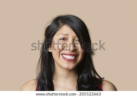 Portrait of a beautiful happy woman over colored background - stock photo