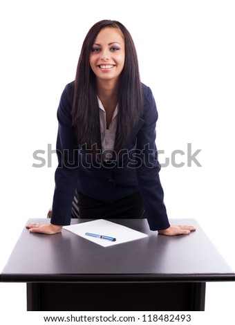 Portrait of a beautiful hispanic businesswoman standing with hands on desk isolated on white background - stock photo