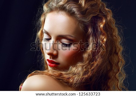 Portrait of a Beautiful Hot Girl With Long Curly Red Hair - stock photo