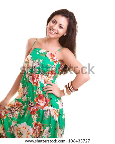 Portrait of a beautiful indian girl in summer dress on studio - stock photo