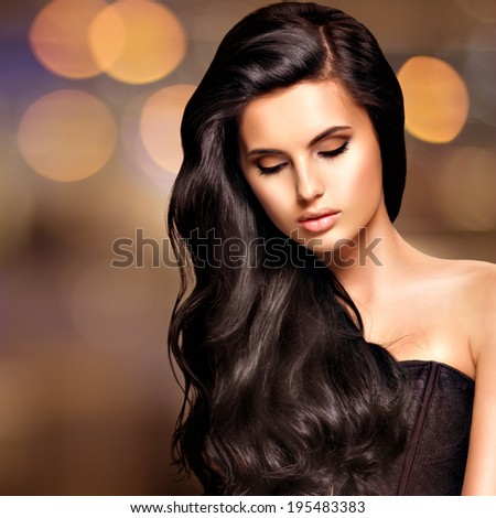 Portrait of a beautiful indian woman with long hairs over art creative background - stock photo