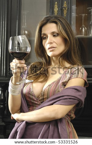 Portrait of a beautiful lady with glass of red wine - stock photo