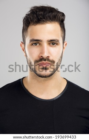 Portrait of a beautiful latin man with a serious expression - stock photo