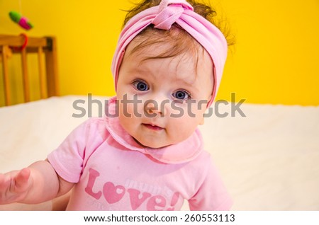 Portrait of a beautiful little baby girl with a bandage on his head - stock photo