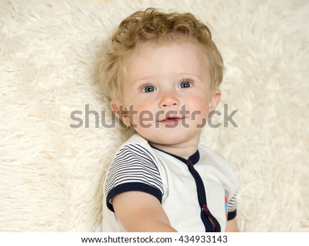 portrait of a beautiful little boy with curly hair - stock photo