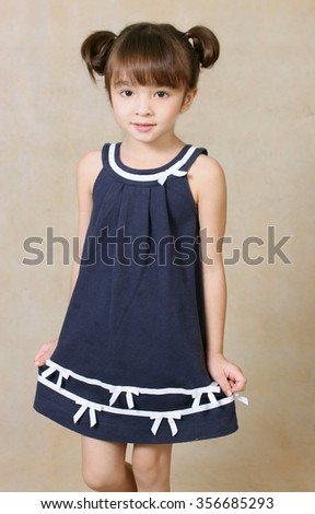 Portrait of a beautiful little girl ,isolated on light brown background - stock photo