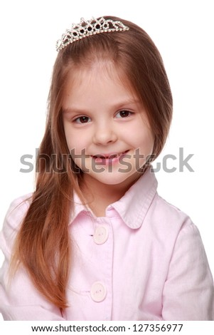 Portrait of a beautiful little girl with a tiara on her head - stock photo