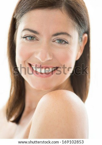 portrait of a beautiful mature lady looking at the camera with a confident smile - stock photo