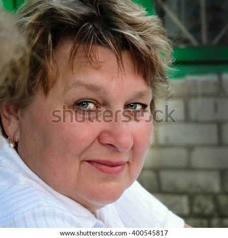 Portrait of a beautiful mature woman in her early sixties - stock photo
