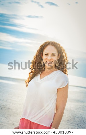Portrait of a beautiful middle aged woman outdoor at the beach portrait - stock photo