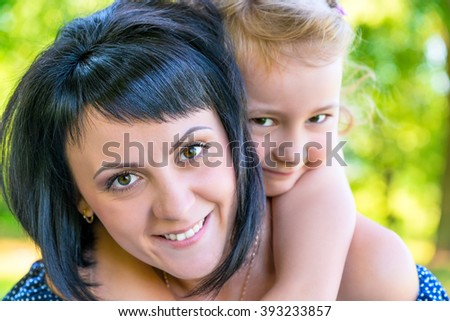 portrait of a beautiful mother and daughter close-up - stock photo