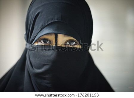 Portrait of a beautiful Muslim Arabic girl - stock photo