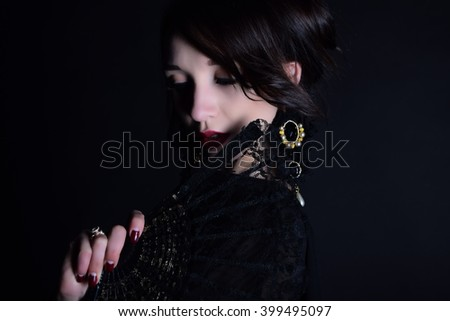 Portrait of a beautiful mysterious woman, red lipstick and fan - stock photo