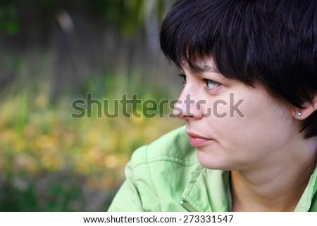 portrait of a beautiful pensive woman close up - stock photo