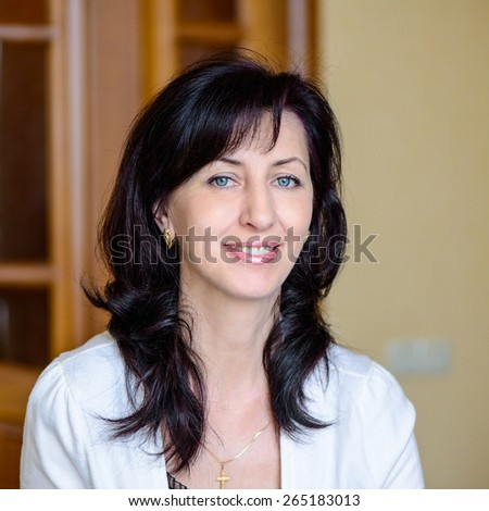 portrait of a beautiful positive adult woman - stock photo
